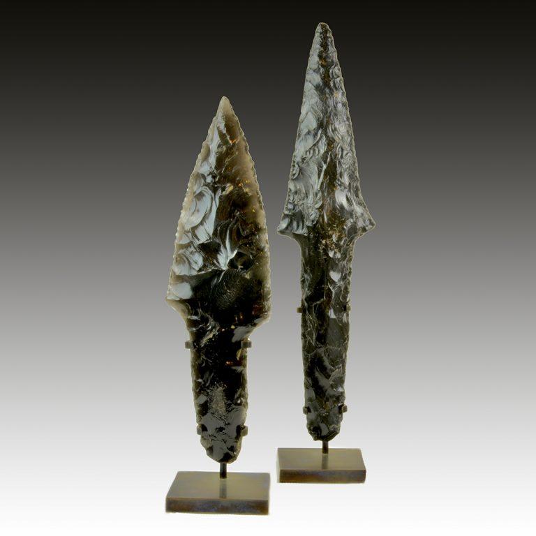 Two obsidian daggers